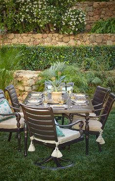 Our British Colonial Dining Set invites you to entertain with a unique blend of classically inspired forms featuring a generous dash of the exotic. Pineapples and acanthus leaves grace the arm chairs.   Frontgate: Live Beautifully Outdoors