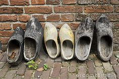 Dutch Wooden shoes in a row by Patricia  Hofmeester, via Dreamstime