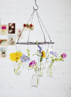 DIY wire and glass bottle hanging flower chandelier - Thanks, Sweet Paul!