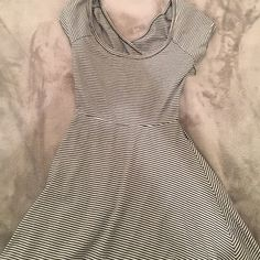 Brandy Melville dress This dress is dark blue and white striped. It has a cut out in the back and has two pieces of fabric that cross over (as shown in photos). This dress is one size fits all, but it is pretty small! Brandy Melville Dresses