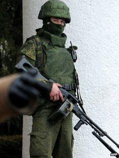 Ukraine Crisis, live updates, BBC News Europe Feb 28 2014 photo:  A man in combat uniform armed with a machine-gun outside Simferopol airport, 28 February