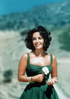 Elizabeth Taylor. Teal and blue.