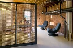 Interesting consideration for creating 'private' work spaces in an open work space Creative Office Space, Office Spaces, Work Spaces, Metal Mesh Screen, Open Office, Wall Treatments, Architecture Design, Design Inspiration, Interior Design