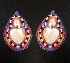 The heart shell bead is paired with a mini Swarovski gem and surrounded by variously colored size 11 seed beads. ♡ All earrings are finished with a beaded edging and backed with leather sheepskin. The earring hooks are surgical steel hooks and will come with rubber backings to prevent loss. ♡