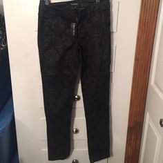 White Black house brand new black pants White Black House brand new black pants with floral print-tag included- xs but runs small - small waist White House Black Market Pants Boot Cut & Flare