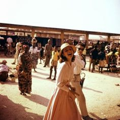 Audrey Hepburn at a market in 1958, photographed by Leo Fuchs