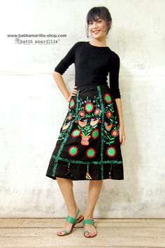 Batik Amarillis made in Indonesia.                             Batik Amarillis's Arcana skirt Tap Batik Amarillis's folksy spirit with this beautifully A Line Silhoutte , rows of signature 'Arcana' tassels , Ukrainian embroidery  inspired completed western Bohemian details synonymous with Indonesian culture #batikskirt #batikamarillis #batikindonesia #ukrainian #embroidery