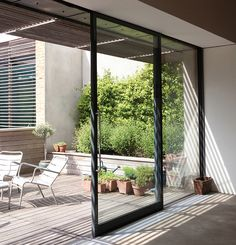 sliding door balcony with light passing through wooden slats