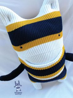 Hockey Softie! Made of upcycled hockey socks - just make sure you wash em first! That hockey smell lasts forever