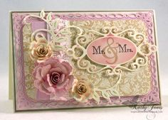 Die cut and layered with Spellbinders: Romantic Rectangles, Fancy Tags Two, Bitty Blossoms and Foliage Two.