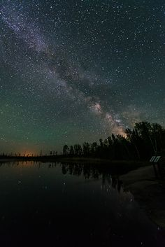 """Milky Way rising above Whiteshell River in Whiteshell provincial park, Manitoba, Canada. / Photo """"Rising In The East"""" by Nebojsa Novakovic Canada Travel, Canada Trip, Lake Winnipeg, What A Wonderful World, Heaven On Earth, Milky Way, Wonders Of The World, Adventure Travel, Northern Lights"""