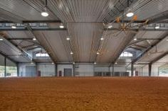 Warm up arena, a covered area great for use during horse shows, or livestock shows. Fans for ventilation keep it comfortable year round.