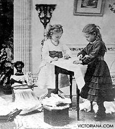 Two girls play with antique dolls, c 1870s