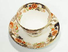 Rare Hard To Find Radfords Fenton England Floral & Greek Key Bone China Cup & Saucer Pattern #974  Saucer is 5 3/8 (d)  Cup is 2 1/8 (h) x 4 3/8 (with handle) Overall very good pre-owned condition with signs of wear and aging. No major cracks, just a few small manufacturing imperfections and small defects.