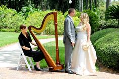 Cypress Grove destination wedding by RW Events. This is a very popular wedding location in south Orlando with a lakefront ceremony gazebo.  Photo by Snap Photography. #cypressgrovewedding #wedding #cypressgrove #Orlando #gazebo #harpist