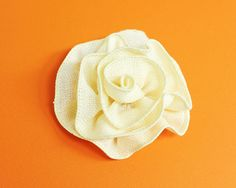 Ever wonder how you can make a pretty fabric flower in minutes? Using wired ribbon, you can quickly make a floral embellishment for gifts, a...