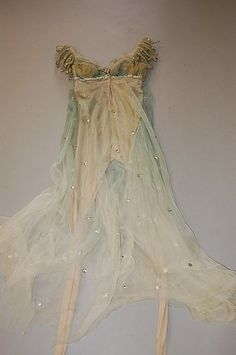 Margot Fonteyn's costume from `Ondine', designed by Lili de Nobili, 1958, comprising: tiered, floating gown of aquamarine chiffon spotted with pastes, with jewelled brooch to breast, with integral...
