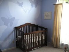 A view of our baby girl's crib, the hand-painted butterflies nursery wall mural in shades of lavender and window treatments. When thinking of decorating Lily's nursery, I knew I wanted to do butterflies theme for our baby girl, but in an untraditional way.  I had seen a nursery