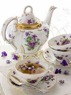 Gorgeous tea set. the violets look so real.