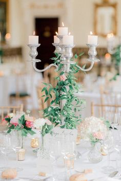 After spending a week in a French Château with friends and family, Emily and Jeff tied the knot in style! Check out their French Château wedding here. Candleabra Wedding Centerpieces, Wedding Flower Arrangements, Candelabra, Wedding Flowers, Party Table Decorations, Wedding Decorations, Wedding Table Settings, Wedding Tables