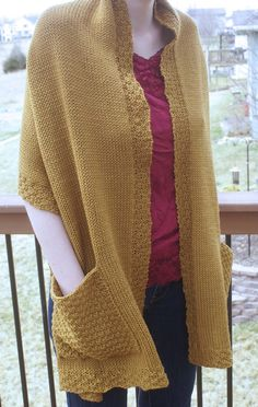 Knitting Pattern for Reader's Wrap - Stockinette shawl with large textured pockets by Lisa Carnahan in worsted yarn. Pictured project by nebraskagirl86
