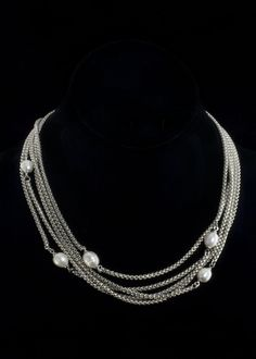 """Rhodium Chain Necklace  Rhodium plated five chain and fresh water pearl necklace. Necklace length is 18"""""""" with a toggle clasp.   http://www.sterlingjewelrystores.com/product646.html"""