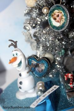 An adorable handmade 1:12 scale Frozen inspired Christmas tree. Set includes Sven, Anna, troll and Olaf characters + gifts for the Frozen family. A tree is decorated with images of the beloved characters. Free shipping worldwide Frozen Christmas Tree, Miniature Christmas Trees, Before Christmas, Christmas Tree Ornaments, Christmas Gifts, Holiday, Olaf Character, Disney Concept Art, Garden Items