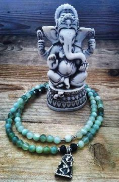 Absolute Bliss necklace with Jade and Emerald beads, and a ganesha pendant.