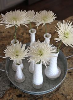We're loving these #milkglass #vases @Matty Chuah Goodwill Gal found!