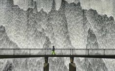 UK weather flooding: Water overflows from Wet Sleddale Reservoir in Cumbria down the 21 metre high dam wall, creating a wall of water following heavy rain resulting in a dramatic scene that can be seen for miles around.