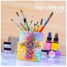An amazing altered tin! Come check it out over on our blog blog.lindystampgang.com #mixedmedia #altereditem #DIY #pencilholder #sprays