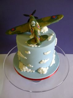 It isn't every day you're asked to make a cake for a veteran fighter pilot, so it was a tremendous honour to make this Spitfire cake. It was a tall triple layer chocolate cake, sandwiched with lashings of salted chocolate buttercream and. Themed Birthday Cakes, Themed Cakes, Gorgeous Cakes, Amazing Cakes, Mini Cakes, Cupcake Cakes, Triple Layer Chocolate Cake, Octopus Cake, Rocket Cake
