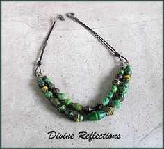 Paper Bead Necklace Leather, Fair Trade Necklace Leather,Leather Paper Bead Necklace,Leather Fair Trade Necklace, Green Paper Bead  Necklace by DivineReflections on Etsy https://www.etsy.com/listing/464991371/paper-bead-necklace-leather-fair-trade