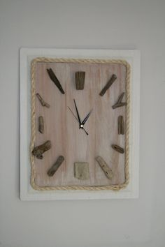 Handmade Driftwood wall clock edged in sisal sweeping non ticking clock mechanism reclaimed wood