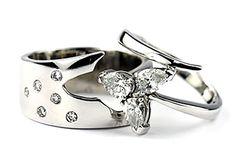 bespoke interlocking wedding ring with pear-shaped diamond ring