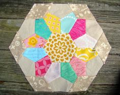 Love everything about this block, especially colors: http://www.theplaidscottie.com/2014/04/quilt-journey.html