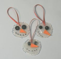 Melted Snowman Ornaments. Hot glue on foil, decorate and let dry. Simple and cute