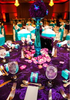 turquoise and purple wedding- used turquoise glass pillars with purple pomeander flowers on top (reused from ceremony from the pews) - Click image to find more weddings posts