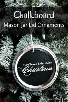Chalkboard Mason Jar Lid Ornaments - Create your own Chalkboard Mason Jar Lid Ornaments by upcycling your old & used canning lids & rings!  #chalkboard #Christm…