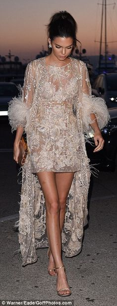 Kendall Jenner dares to bare in sparkling sheer mini with matching feathered coat as she joins mum Kris and Scott Disick at star-studded Chopard bash in Cannes | Daily Mail Online