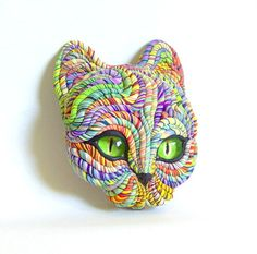I think this is so cool, and the colors are gorgeous!! Cosmic Cat Art Sculpture Green Eyes by JanePriserArts