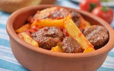 Turkish meatball kofte with potato under tomato sauce Selective focus Turkish Recipes, Greek Recipes, Ethnic Recipes, Turkish Meatballs, Egyptian Food, Arabic Food, Meatball Recipes, Different Recipes, Tomato Sauce