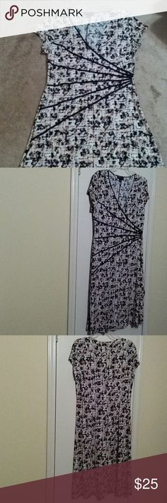 Beautiful A-line dress NWOT Multi-color V-neck dress with detailing which accentuate the waistline.  Pink, tan & black connected  Dresses Midi