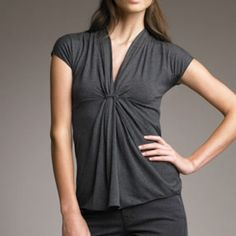 Armani Collezioni Gray V-Neck Pleated Top 10 NWT Armani Collezioni a Dark Gray V-Neck Pleated Top, Viscose/acrylic/spandex. Shirt, size 10, really soft,  cap sleeves, empire waist, ruching softens front sweep. NWT Giorgio Armani Tops