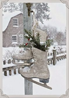 Vintage skates hanging on the lamp post on a snowy winter day. Aiken House & Gardens...