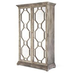 A tall, light and handsome addition to your bedroom, this dresser holds four shelves of clothing, linens or any other comforts of home. The full-length, antique mirrored doors lend Hollywood glamour to the distressed birch cabinet. The four interior shelves and hanging rod adjust, creating a storage space as unique as the contents.