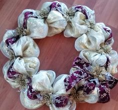 Beautiful gold deco mesh wreath with velvet wine colored ribbon with golden accents. Beautiful wreath!