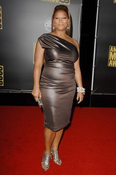 "This is Queen Latifah doing what's called a ""wiggle dress."" Now, I like Queen Latifah and she usually has good taste - but not here! This is obviously either not fitting well or is made of some nasty fabric with too much spandex in it! I'm plus-sized, too, Queen, and nobody needs to see every fold, line, and wrinkle on our bodies, plus extra ones we don't even have, for god's sake! Are you crazy, girl? You want to wiggle? Try getting into a pair of pantyhose! This is flat-out nasty!!! Only…"