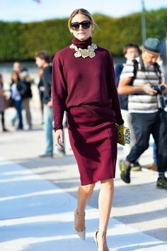 Go monochrome like Olivia Palermo, wearing a loose turtleneck and pencil skirt in burgundy with a statement necklace