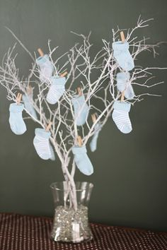 advice for mom on blue and white bootie socks then hang on this tree